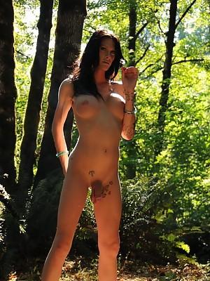 Brunette TS Morgan Bailey showing her big schlong & tits